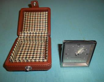 One (1), Vintage, Cutter & Buck, Quartz Travel Alarm Clock, in Leather Case.