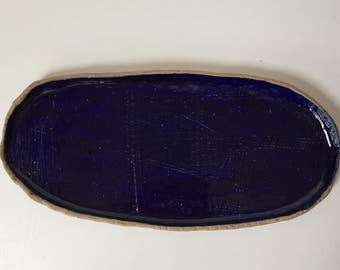 Oblong, organic, cobalt blue serving dish with some texture.