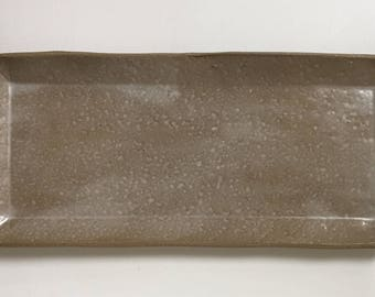 Long, rectangular serving dish with gentle surface texture and milky glaze.