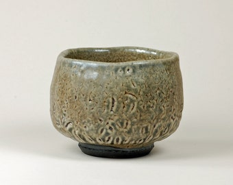 Black clay shino glazed tea bowl