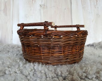 A very useful  round basket with stick wooden handles,