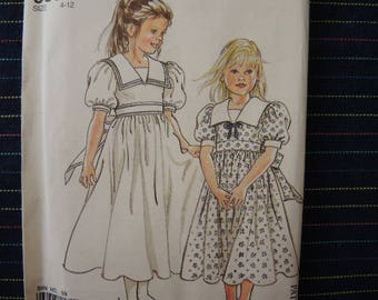 vintage 1990s Simplicity sewing pattern 9831 UNCUT girls dress size 4-12