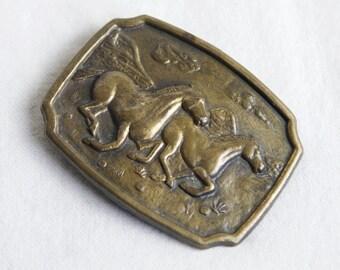 Vintage horse belt buckle…running horses buckle.
