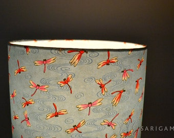 Lampshade handmade with a blue japanese paper with a dragonflies