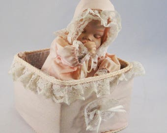 Porcelain Baby in Pink Moving Music Box, Sucking Thumb