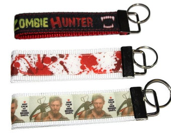 Zombie Hunter Daryl Dixon The Walking Dead Blood Splatter Keychain/Keyfobs.  Zombie Lovers Keychains.