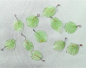 Glass leaves to use, 11, Bohemian, vintage.  Dainty transluscent green pressed glass leaves with inset wires with looped ends. c1930's.
