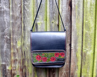Black leather messenger bag with tooled red roses with a complimentary roses book-marker