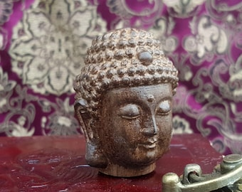 Wooden Siddhartha Buddha head figurine