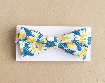 blue and white bow tie with large yellow floral