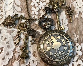 "Antique Bronze, Charm, Pocket Watch Necklace, Inspired By ""Alice In Wonderland""."