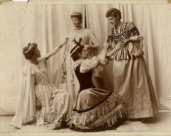 Pretty women in amazing costumes antique photo