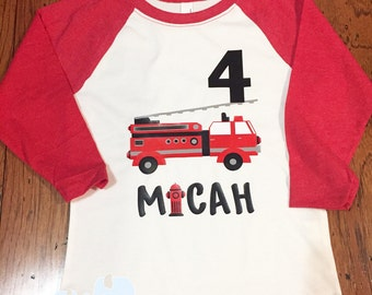 Kids red raglan with fire truck and number with name.