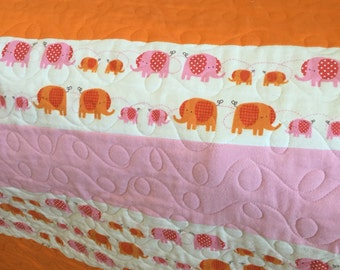 Beautiful quilt in elephant print cotton flannel fabric Machine quilted by me. An heirloom quality quilt for the baby/ toddler