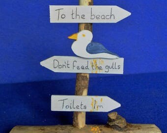 Cheeky seagull on sign post made from Cornish driftwood St.Ives Cornwall reminder