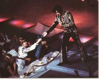 Elvis Presley , Elvis on stage in the 1970's