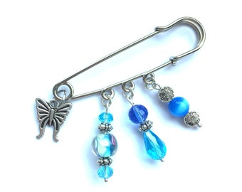 Safety pin brooch with butterly charm, turquoise and blue murano and crystals