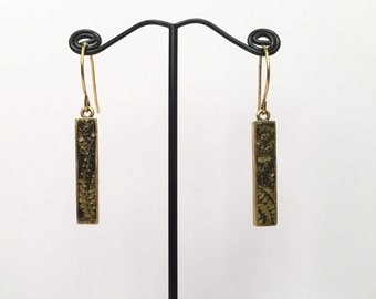 Black and gold patterned dangle earrings