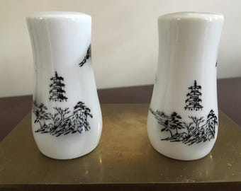 Vintage pair of white black pagoda salt and pepper shakers