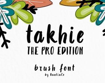 Takhie Pro | Multilingual Brush Font