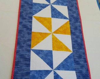 Quilted table runner in blue and yellow