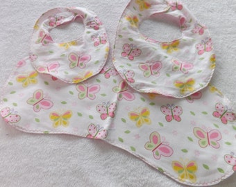 newborn baby bib and burp cloth gift set made from pink, green, and yellow butterflies on white flannel and backed with pink stars