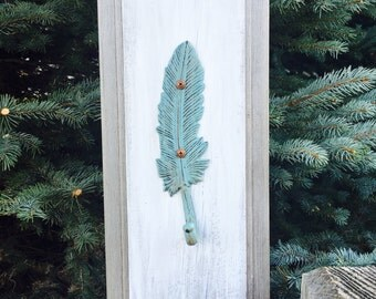 Turquoise Feather hanger on Reclaimed Wood