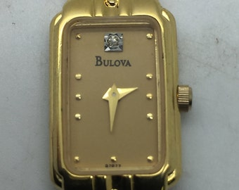 Vintage Ladies BULOVA 97P77 Stainless Steel Gold Plated Diamond Dial 14mm Watch; sku #5949
