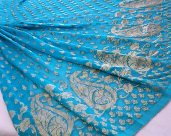 aqua blue georgette with dull Paisley pattern at border base fabric