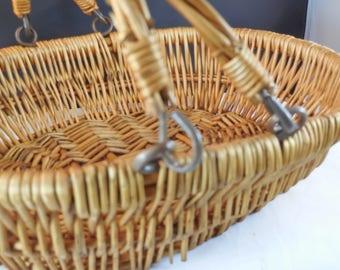 Wicker basket with metal loop clasp on the handles.