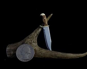 Handmade miniature bowie knife