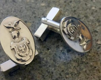 Heraldic Cufflinks: shield helmet and family crest falcon