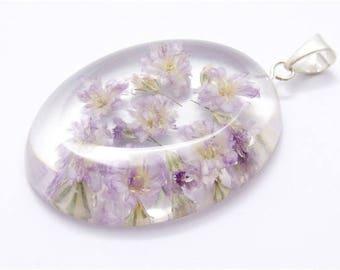Oval pendant with gypsophila flowers