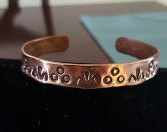 Stamped copper cuff braclet