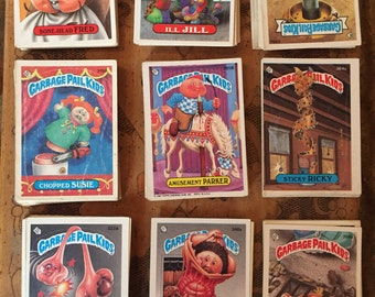Rare one hundred and seventeen 1980s vintage Garbage Pail Kids sticker trading cards 80s punk stuff Glue sniffing fun teenage hobby Ramones