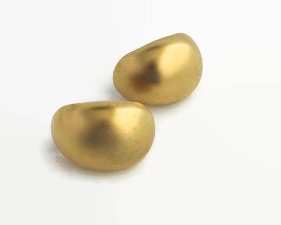 Vintage gold tone metal earrings, classic style, large domed ovals with textured metal appearance, clip ons, circa 1980s