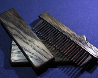 Wooden comb in the case of bog oak (2000 years old) Age of Christ