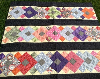 Hand sewn quilt, walkabout fabric collection