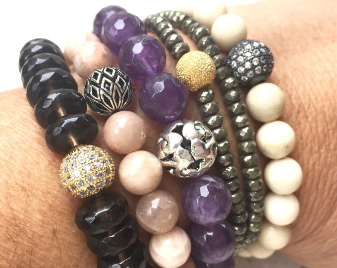 Sunstone, with Pyrite, Fossil Stone, Amethyst and Smokey Quartz stack bracelets.