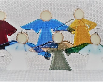 Handmade fused glass angel ornaments.