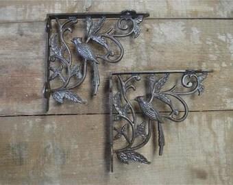 A pair of cast iron antique Victorian style exotic bird brackets AL23