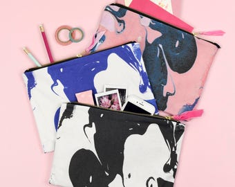 Marbled zip pouch clutch bag