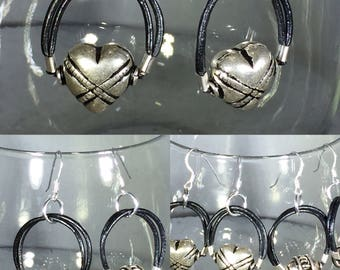 Sterling silver hearts or oval hoops on black leather