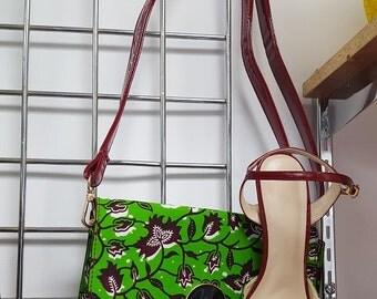 Bag slung leather and printed green wax sheet