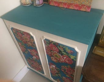 sold. funky floral cupboard