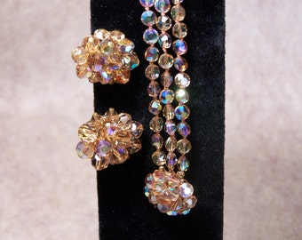 Vintage aurora borealis triple strand bracelet and cluster earring set