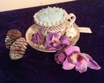Pretty teacup pin cushion with blue insert