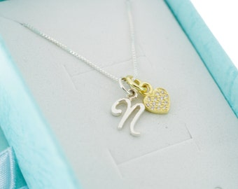 Little girl's initial necklace accented by a 14K gold plated sterling silver CZ heart on a sterling silver box chain. Initial Necklace.