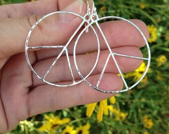 Peace sign earrings handmade out of sterling silver, hammered, each one a little different