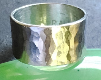 Shiny hammered wide sterling ring.